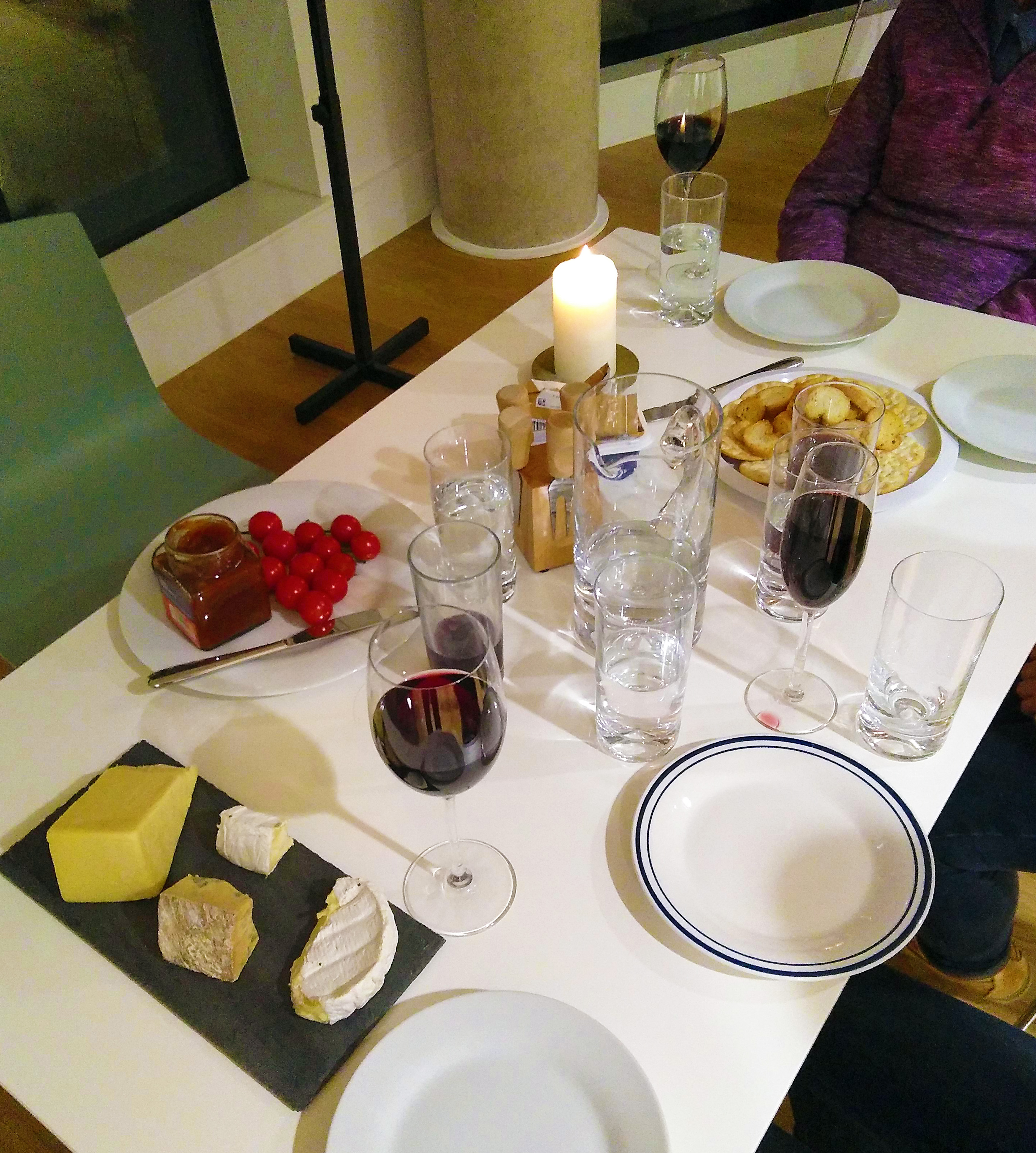 Table set with cheese and wine